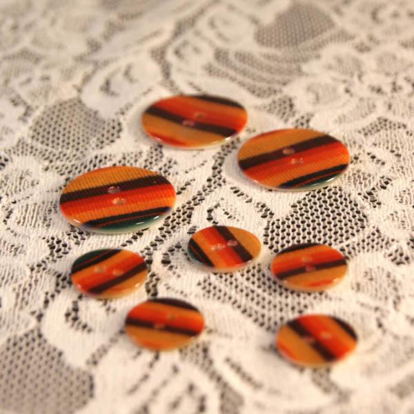 Knapp pärlemor orangerandig