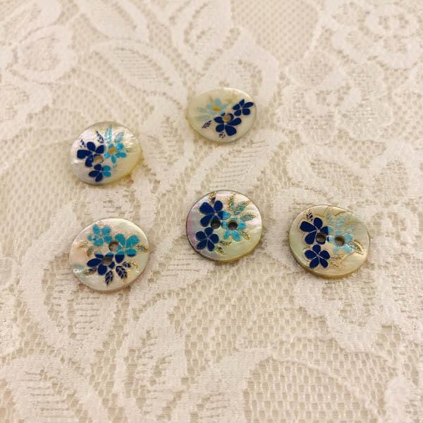 Knapp pärlemor blomma 16mm blå