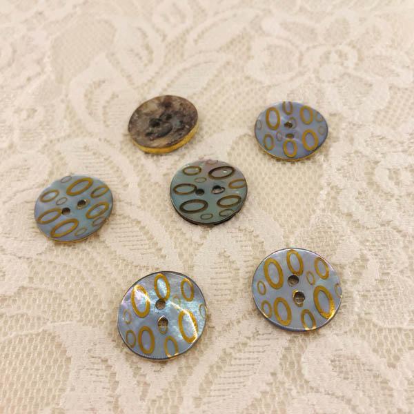 Knapp pärlemor mönster oval i guld ljusblå